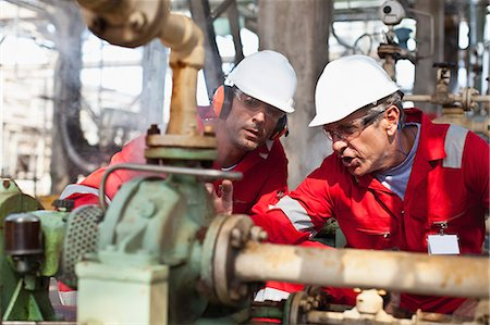 refinery - Workers examining equipment on site Stock Photo - Premium Royalty-Free, Code: 649-06040465