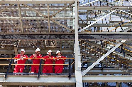 platform - Workers standing on ledge together Stock Photo - Premium Royalty-Free, Code: 649-06040463