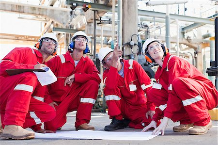 refinery - Workers with blueprints at oil refinery Stock Photo - Premium Royalty-Free, Code: 649-06040476