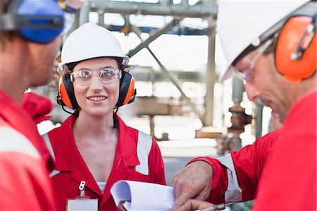 refinery - Workers talking at oil refinery Stock Photo - Premium Royalty-Free, Code: 649-06040473