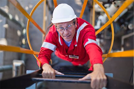 refinery - Worker climbing ladder at oil refinery Stock Photo - Premium Royalty-Free, Code: 649-06040484