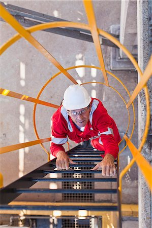 refinery - Worker climbing ladder at oil refinery Stock Photo - Premium Royalty-Free, Code: 649-06040482