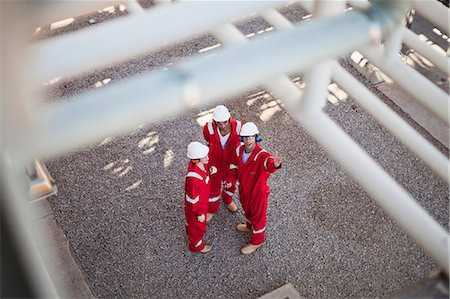 refinery - Workers talking at oil refinery Stock Photo - Premium Royalty-Free, Code: 649-06040483