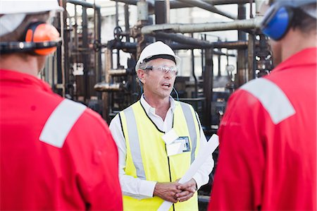 refinery - Workers talking at chemical plant Stock Photo - Premium Royalty-Free, Code: 649-06040554