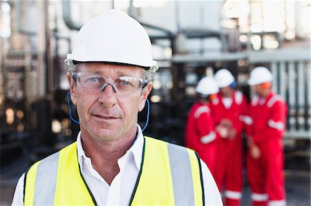 refinery - Worker standing at chemical plant Stock Photo - Premium Royalty-Free, Code: 649-06040556
