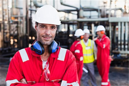 refinery - Worker standing at chemical plant Stock Photo - Premium Royalty-Free, Code: 649-06040557