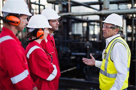 refinery - Workers talking at chemical plant Stock Photo - Premium Royalty-Free, Code: 649-06040553