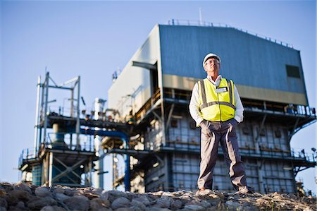 refinery - Worker standing at chemical plant Stock Photo - Premium Royalty-Free, Code: 649-06040565