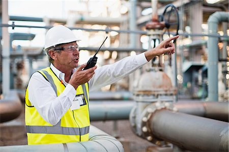 refinery - Worker using walkie talkie on site Stock Photo - Premium Royalty-Free, Code: 649-06040563