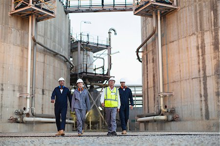 refinery - Workers walking at chemical plant Stock Photo - Premium Royalty-Free, Code: 649-06040576