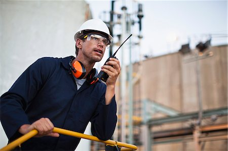 refinery - Worker using walkie talkie on site Stock Photo - Premium Royalty-Free, Code: 649-06040578