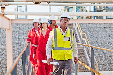 refinery - Workers walking at chemical plant Stock Photo - Premium Royalty-Free, Code: 649-06040570