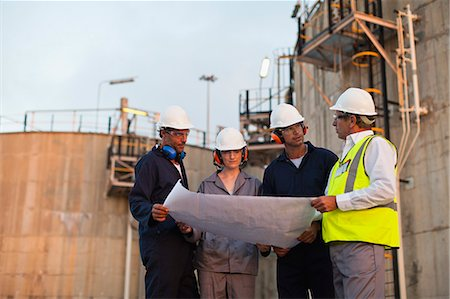 refinery - Workers reading blueprints at plant Stock Photo - Premium Royalty-Free, Code: 649-06040572