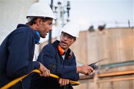 safety - Workers talking at chemical plant Stock Photo - Premium Royalty-Free, Code: 649-06040581