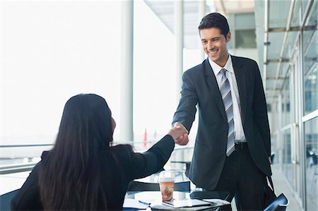 Business people shaking hands in cafe Stock Photo - Premium Royalty-Free, Code: 649-06040603