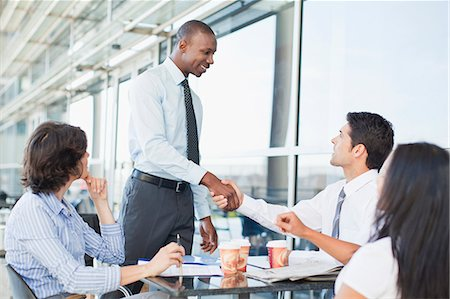 Business people shaking hands in cafe Stock Photo - Premium Royalty-Free, Code: 649-06040612