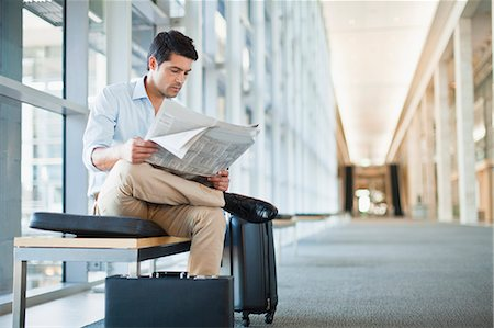 Businessman reading newspaper on bench Stock Photo - Premium Royalty-Free, Code: 649-06040648