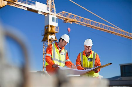 Workers reading blueprints on site Stock Photo - Premium Royalty-Free, Code: 649-06040709