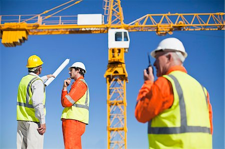 Workers talking at construction site Stock Photo - Premium Royalty-Free, Code: 649-06040719