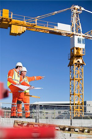 Workers reading blueprints on site Stock Photo - Premium Royalty-Free, Code: 649-06040713