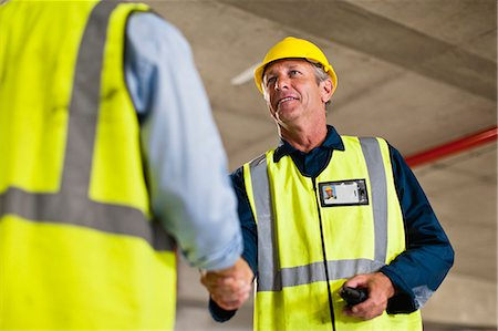 Workers shaking hands on site Stock Photo - Premium Royalty-Free, Code: 649-06040766