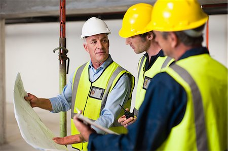 safety - Workers reading blueprints on site Stock Photo - Premium Royalty-Free, Code: 649-06040771