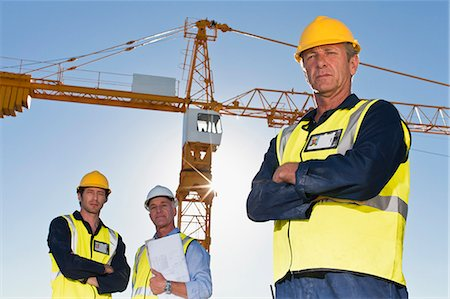Workers standing at construction site Stock Photo - Premium Royalty-Free, Code: 649-06040797