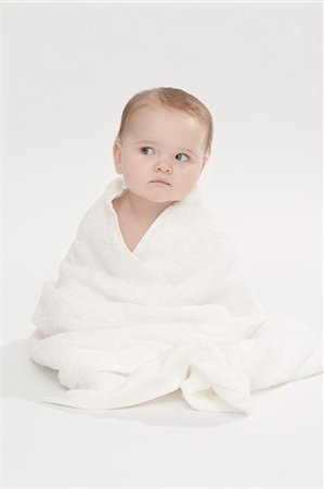 Close up of baby girl wearing bathrobe Stock Photo - Premium Royalty-Free, Code: 649-06040988