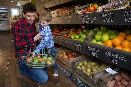 Father and son buying produce in store Stock Photo - Premium Royalty-Free, Code: 649-06041018