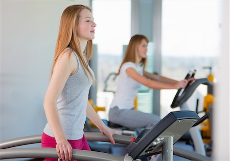 Girl using treadmill in gym Stock Photo - Premium Royalty-Free, Code: 649-06041065