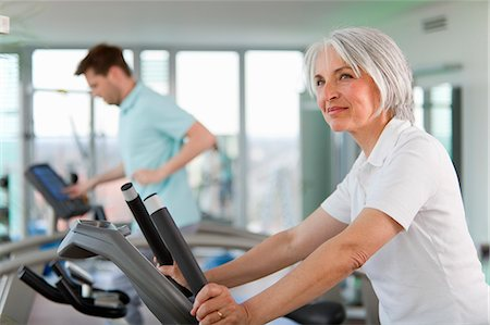 fitness older women gym - Older woman using treadmill in gym Stock Photo - Premium Royalty-Free, Code: 649-06041095