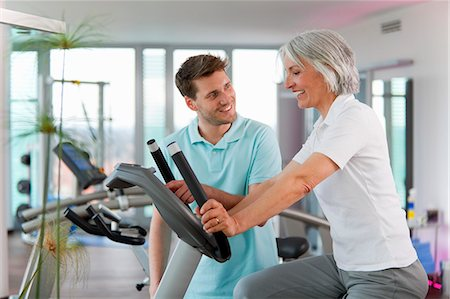 Trainer working with woman in gym Stock Photo - Premium Royalty-Free, Code: 649-06041096
