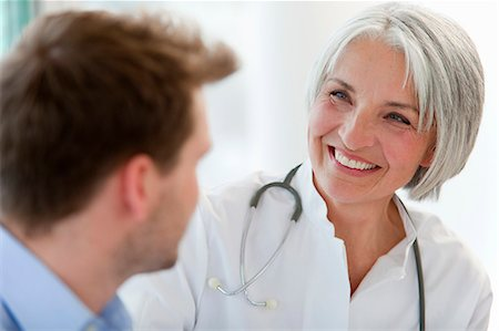 Doctor talking to man in office Stock Photo - Premium Royalty-Free, Code: 649-06041134