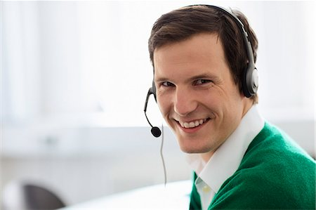 Businessman wearing headset in office Stock Photo - Premium Royalty-Free, Code: 649-06041149