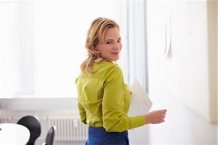 Businesswoman smiling in office Stock Photo - Premium Royalty-Free, Code: 649-06041154