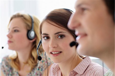Business people working in headsets Stock Photo - Premium Royalty-Free, Code: 649-06041179