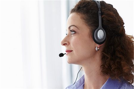 sale - Businesswoman wearing headset in office Stock Photo - Premium Royalty-Free, Code: 649-06041199