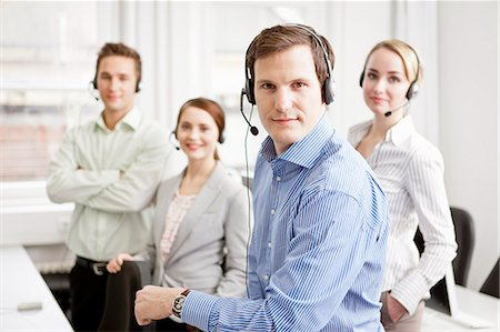 Business people working in headsets Stock Photo - Premium Royalty-Free, Code: 649-06041216