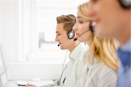 Business people working in headsets Stock Photo - Premium Royalty-Free, Code: 649-06041210