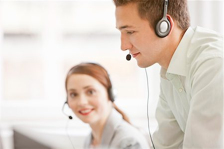 Business people working in headsets Stock Photo - Premium Royalty-Free, Code: 649-06041212