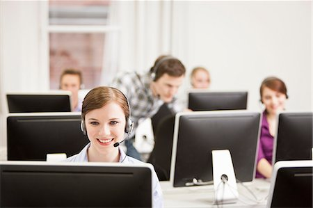 Business people working in headsets Stock Photo - Premium Royalty-Free, Code: 649-06041224