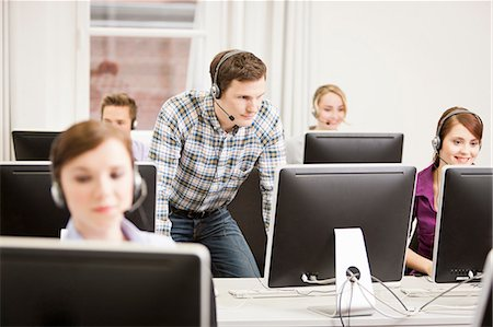sale - Business people working in headsets Stock Photo - Premium Royalty-Free, Code: 649-06041223