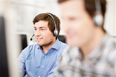 Businessman working in headset Stock Photo - Premium Royalty-Free, Code: 649-06041234