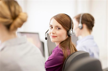 Businesswomen working in headsets Stock Photo - Premium Royalty-Free, Code: 649-06041237