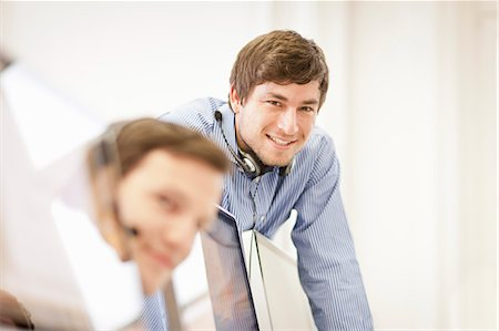 Businessman wearing headset in office Stock Photo - Premium Royalty-Free, Code: 649-06041231