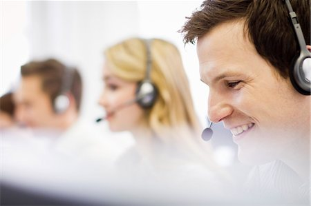 Business people working in headsets Stock Photo - Premium Royalty-Free, Code: 649-06041244
