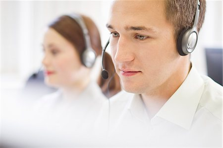 Business people working in headsets Stock Photo - Premium Royalty-Free, Code: 649-06041247