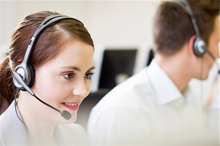 Business people working in headsets Stock Photo - Premium Royalty-Free, Code: 649-06041249