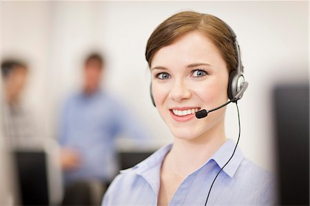 sale - Businesswoman working in headset Stock Photo - Premium Royalty-Free, Code: 649-06041240