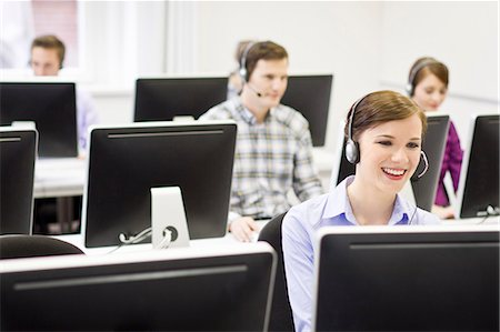 Business people working in headsets Stock Photo - Premium Royalty-Free, Code: 649-06041255